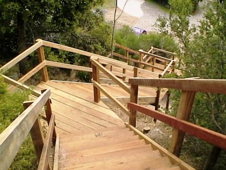 Timber design construction boardwalk footbridge for Cost of building on a steep slope